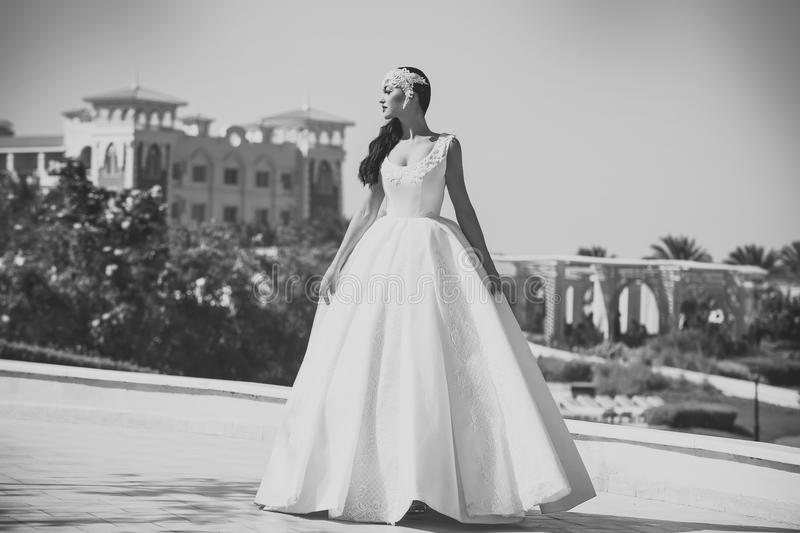 Honeymoon travel concept. Summer vacation and holidays. Bride in white wedding dress stock image