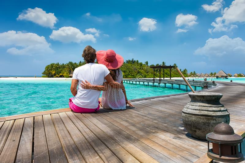 Honeymoon traveller couple in the Maldives islands royalty free stock image