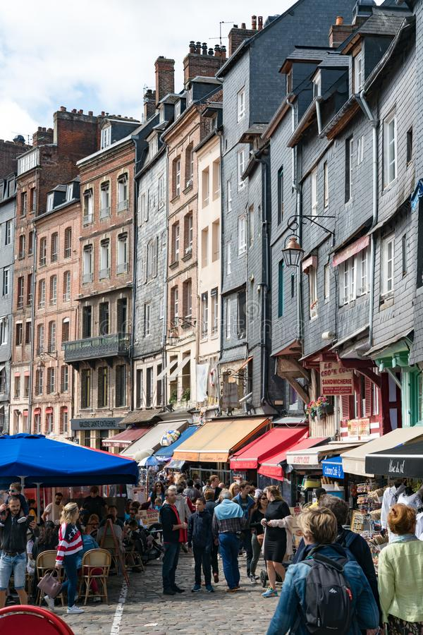 Very crowded old port and restaurant district in the historic city of Honfleur in Normandy on a beautiful summer day in tourist royalty free stock photography