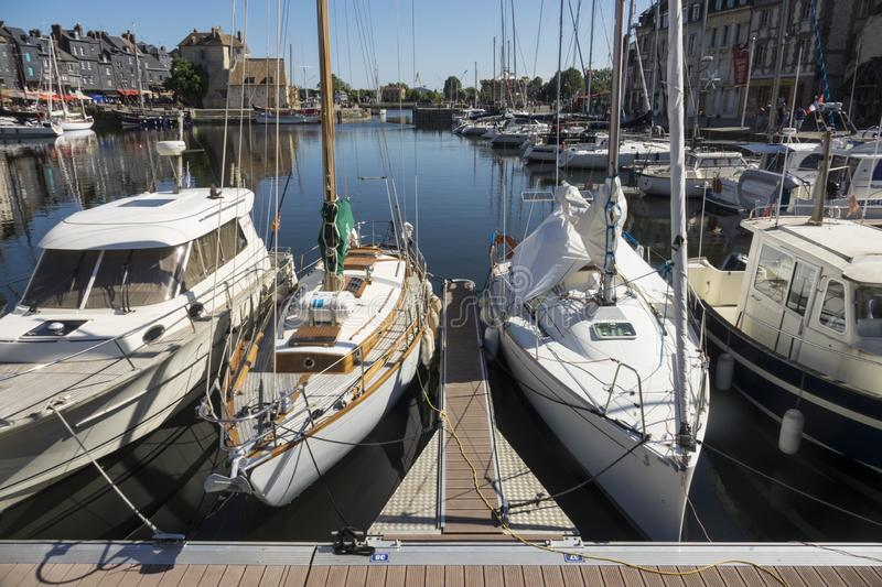 HONFLEUR, FRANCE - July 29, 2019: sailboats and pleasure boats are anchored in the port of Honfleur, France stock photo