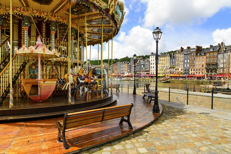 HONFLEUR, NORMANDY / FRANCE - MAY 23, 2013: Carousel in old village harbor. Calvados region. royalty free stock images