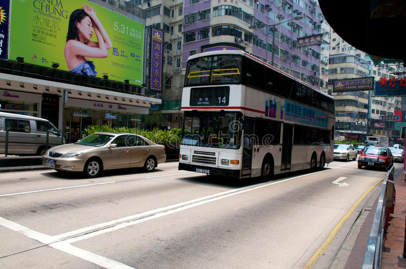 Hong Kong. July 2011, afternoon traffic on  busy roads with typical double decker bus royalty free stock photo