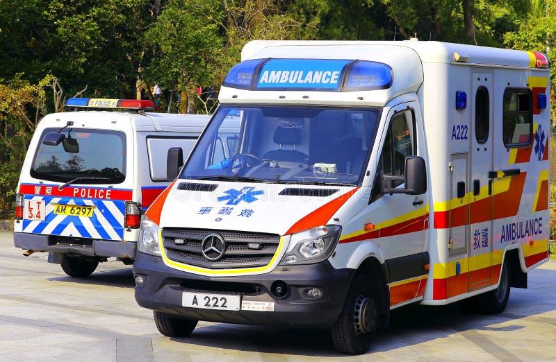 Hong kong ambulance and police van stock photos