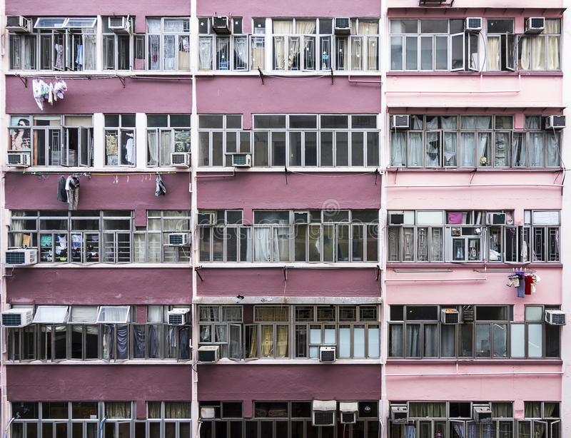 Hong Kong Apartments. The exterior of an apartment building in Hong Kong shows several levels of flats. Laundry hangs from many of the apartments royalty free stock photo