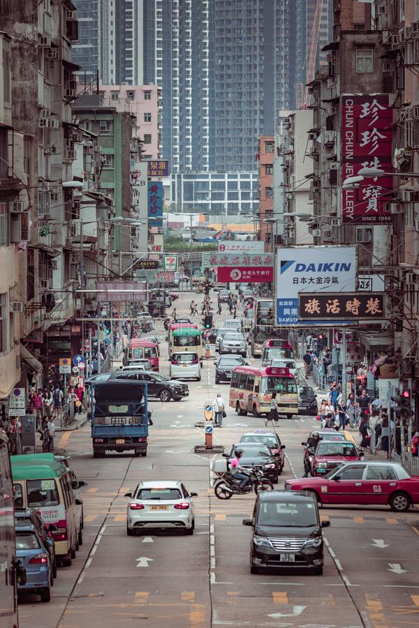 Hong Kong - 28 apr 2019: Old urban area, busy street in the middle of old residential buildings, Kowloon City, Hong Kong. Hong Kong - 28 apr 2019: Old urban area stock photos