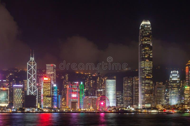 Victoria Harbor of Hong Kong City at a foggy night. Hong Kong - April 23, 2019 : Skyline at Victoria Harbor in Hong Kong. View from Kowloon on HK Island stock photos