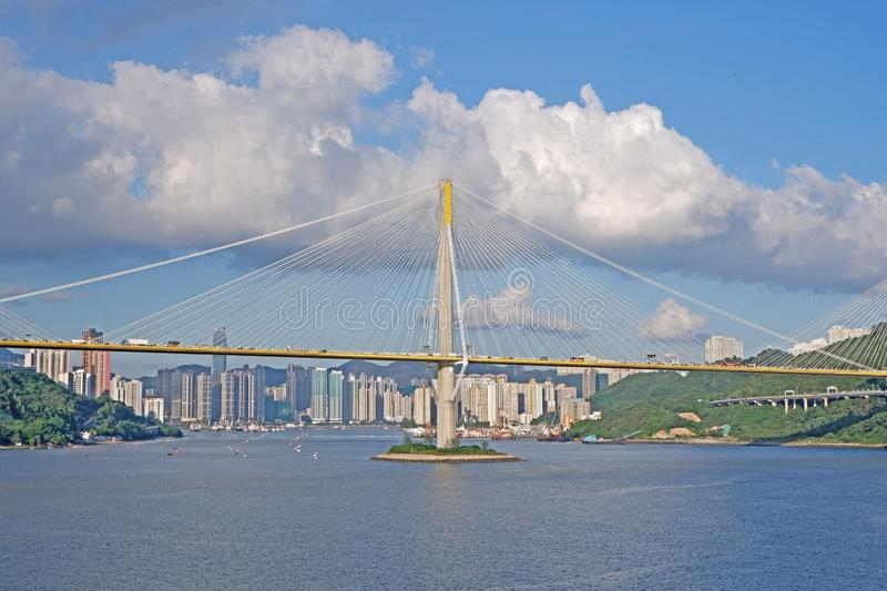 Hong Kong architecture car bridge , buildings, mountain and the bay stock photography