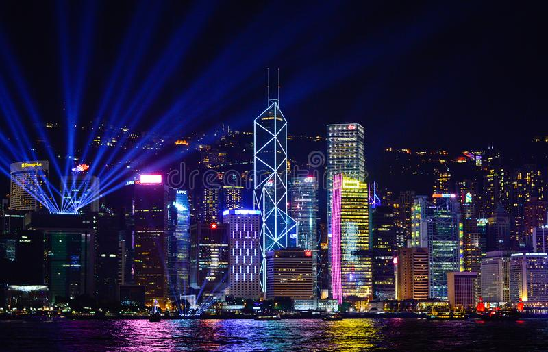 Night View of Hong Kong City Skyscrapers with Flashing Lights from Victoria Harbour Music Show `Symphony of Lights`. Hong Kong, August 2018. Night View of Hong stock image