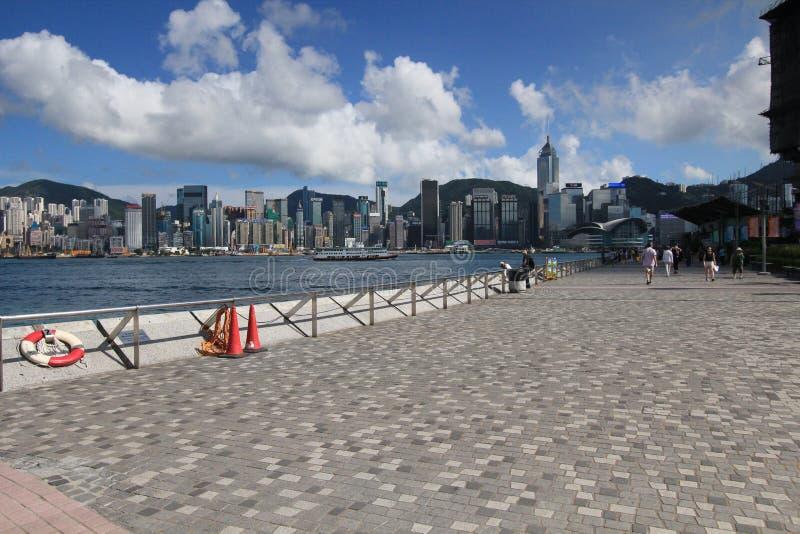 Sky, town, beach, boardwalk, sea, shore, coast, cloud, walkway, water, city, pier, tourism, sand, coastal, and, oceanic, landforms stock photography