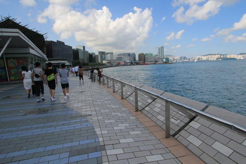 Water, sea, sky, boardwalk, cloud, coast, walkway, recreation, city, ocean, tourism, vacation, beach, tree, pier, leisure, coastal stock photo