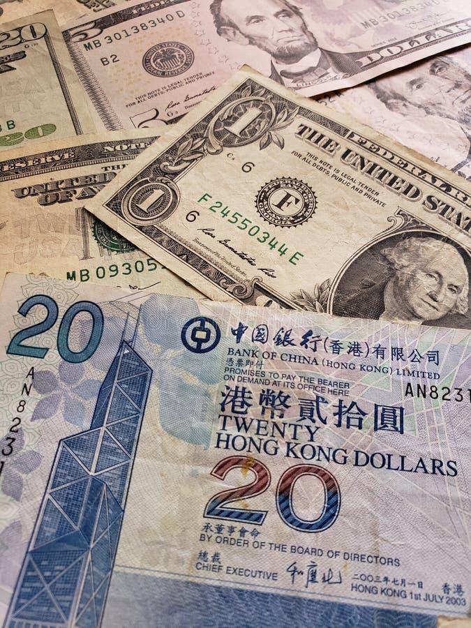Hong Kong-Banknote von zwanzig Dollar und amerikanischen von Dollarscheinen lizenzfreies stockbild
