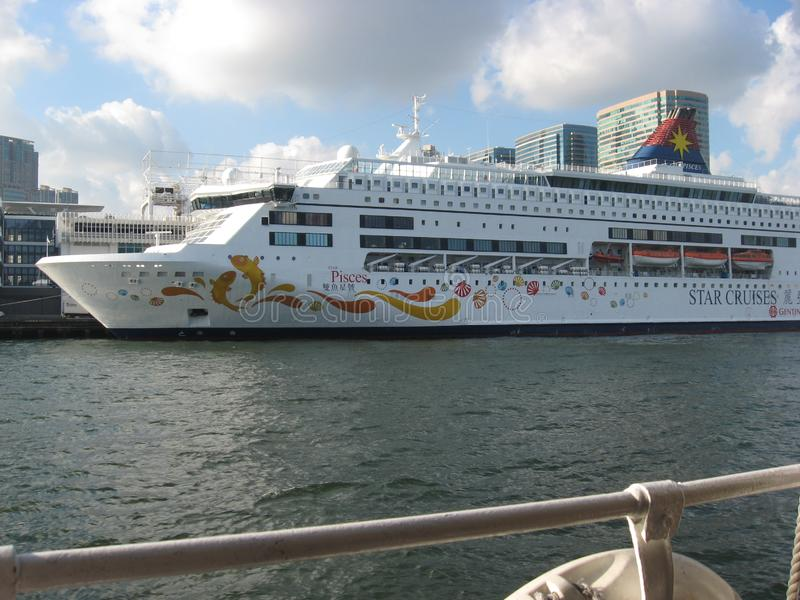 The cruise ship `Pisces` docked in Hong Kong harbour stock photo