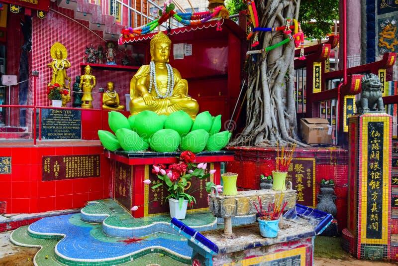 HONG KONG: Buddha statue in Kwun Yam Shrine temple, a Taoist shrine at the southeastern end of Repulse Bay, Hong Kong I royalty free stock photo