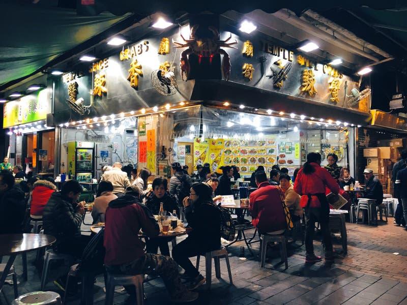 Hong Kong: cena al aire libre, restaurante, mercado de la noche de la calle del templo, Kowloon imagenes de archivo