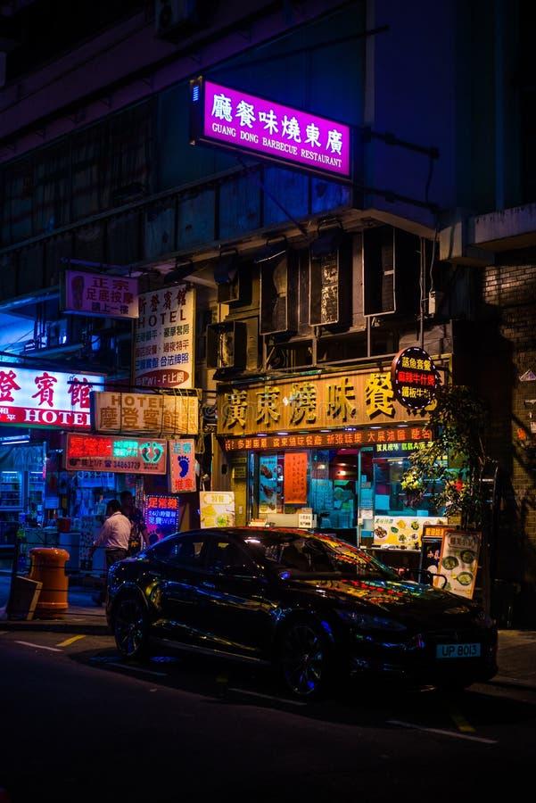 HONG KONG, CHINA - APR 23: Street with Neon Signs at Night stock photo