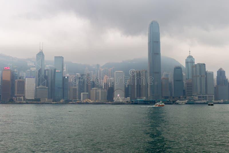 Hong Kong, China - APRIL 24, 2018 - Hong Kong in raining days fr. Om across Victoria Harbor stock images