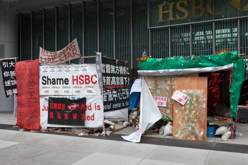 HONG KONG, CHINA/ASIA - 27. FEBRUAR: Protest außerhalb HSBCs in Hon lizenzfreie stockbilder