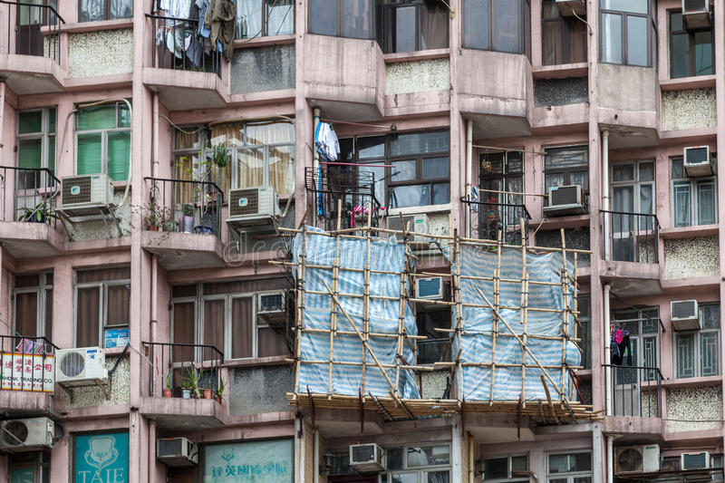 HONG KONG CHINA/ASIA - FEBRUARI 29: Flerfamiljshus i Hong Kong royaltyfri fotografi