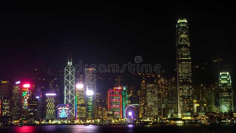 HONG KONG, CHINA - DECEMBER 8, 2016: Hong Kong city skyline at night over Victoria Harbor with clear sky and urban skyscrapers,. Taken from Tsim Sha Tsui royalty free stock image