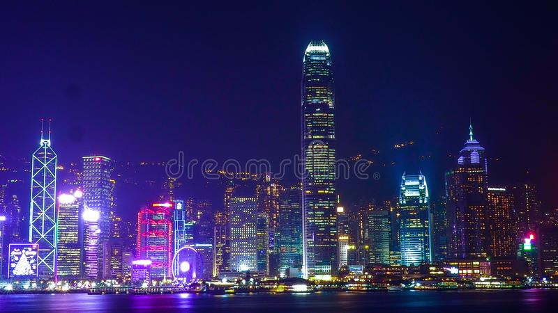 HONG KONG, CHINA - DECEMBER 8, 2016: Hong Kong city skyline at night over Victoria Harbor with clear sky and urban skyscrapers,. Taken from Tsim Sha Tsui royalty free stock photos