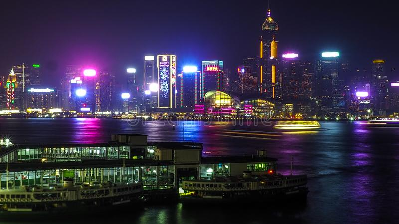 HONG KONG, CHINA - DECEMBER 8, 2016: Hong Kong city skyline at night over Victoria Harbor with clear sky and urban skyscrapers,. Taken from Tsim Sha Tsui stock photo