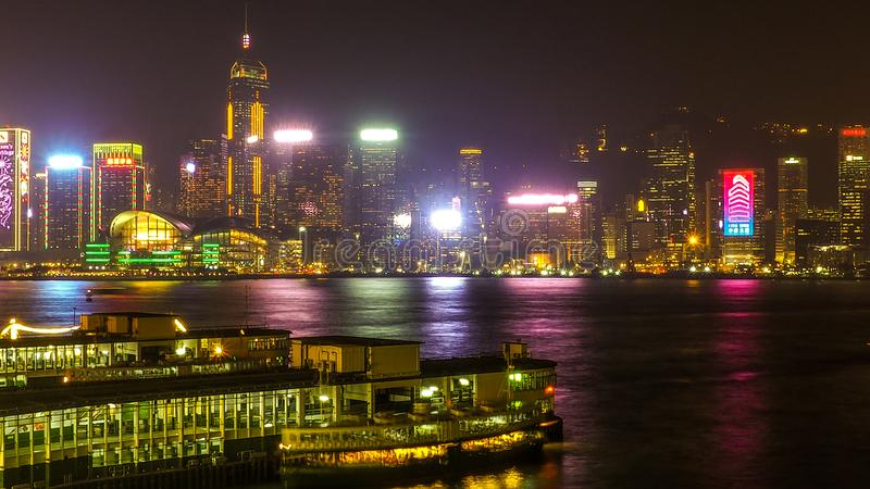 HONG KONG, CHINA - DECEMBER 8, 2016: Hong Kong city skyline at night over Victoria Harbor with clear sky and urban skyscrapers,. Taken from Tsim Sha Tsui royalty free stock photography