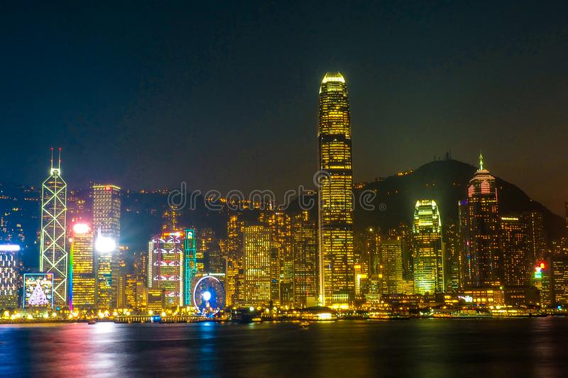 HONG KONG, CHINA - DECEMBER 8, 2016: Hong Kong city skyline at night over Victoria Harbor with clear sky and urban skyscrapers,. Taken from Tsim Sha Tsui stock photos
