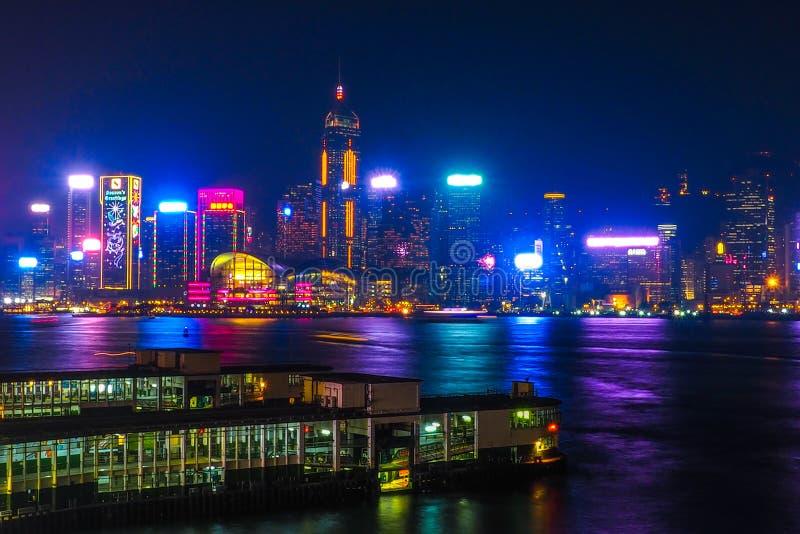 HONG KONG, CHINA - DECEMBER 8, 2016: Hong Kong city skyline at night over Victoria Harbor with clear sky and urban skyscrapers,. HONG KONG, CHINA - DECEMBER 8 stock image