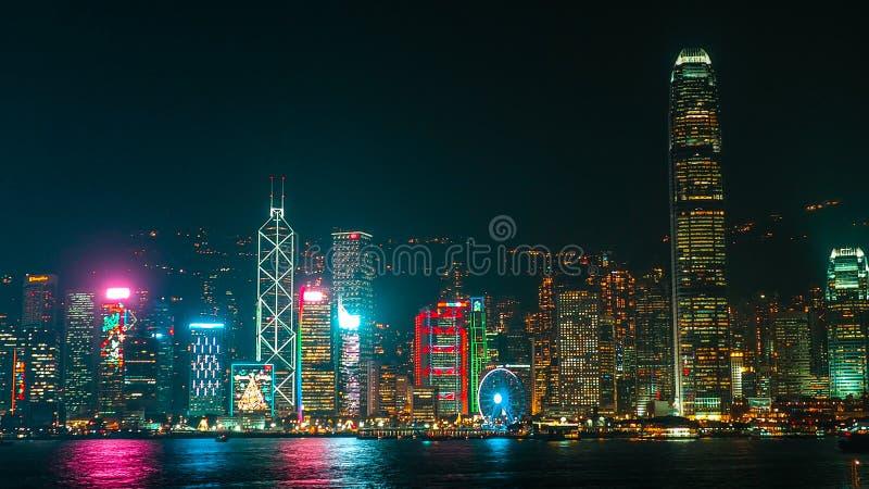 HONG KONG, CHINA - DECEMBER 8, 2016: Hong Kong city skyline at night over Victoria Harbor with clear sky and urban skyscrapers,. HONG KONG, CHINA - DECEMBER 8 royalty free stock photo