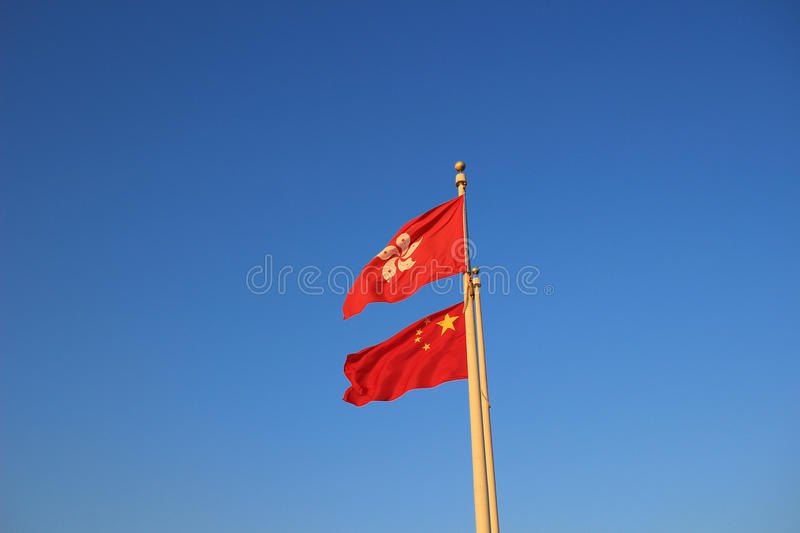 the Hong Kong and China Flags royalty free stock images