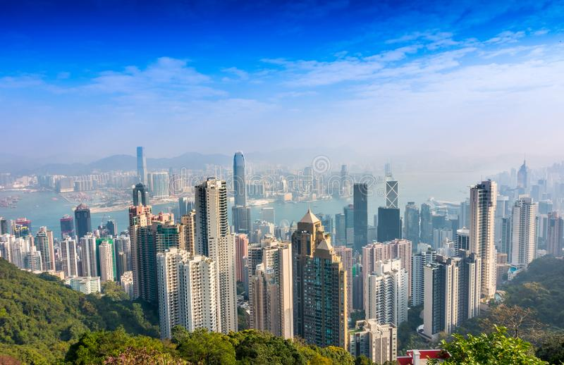 HONG KONG, CHINA - JANUARY 26, 2017: Aerial view of Victoria Harbour and skyscrapers from Lugard Road Lookout, the. Panoramic point most photographed within the royalty free stock photos