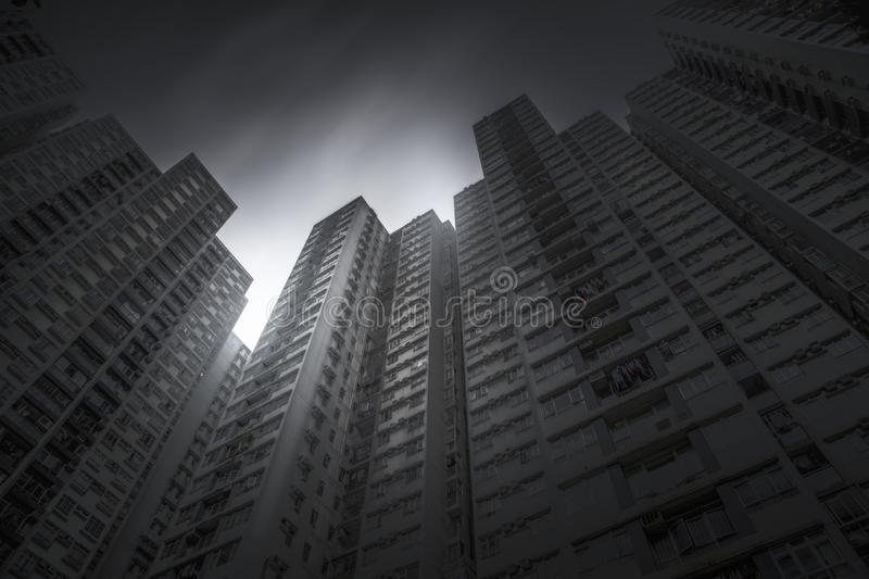 Hong kong, China- July 14, 2019: Hong Kong City and Skyscape. Below view of a skyscraper and a grey sky. Cityscape stock photo
