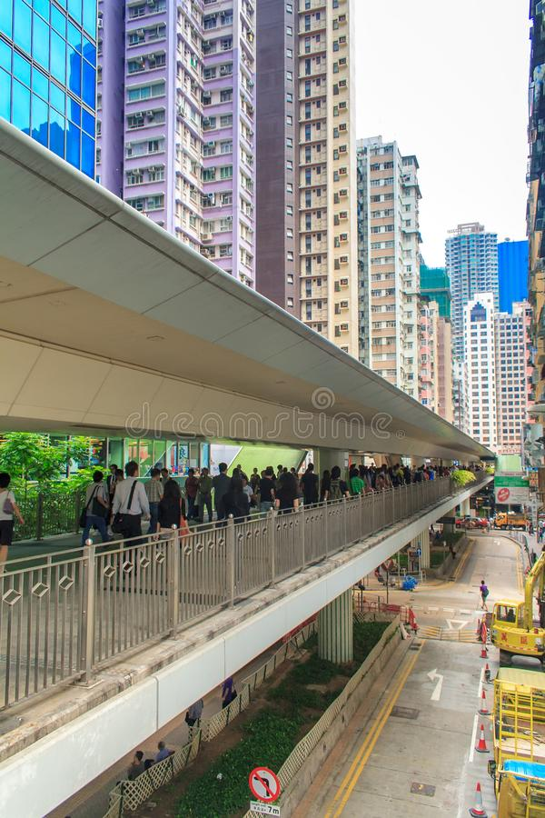 Modern office building and People in a pedestrian overpass downtown in Central Hong Kong royalty free stock images