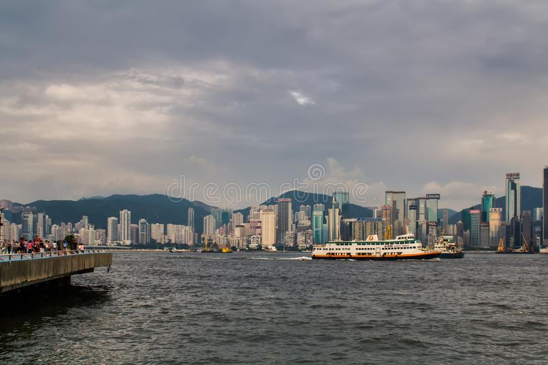 Hong Kong skyline cityscape downtown skyscrapers over Victoria Harbour with tourist ferry boat royalty free stock photos