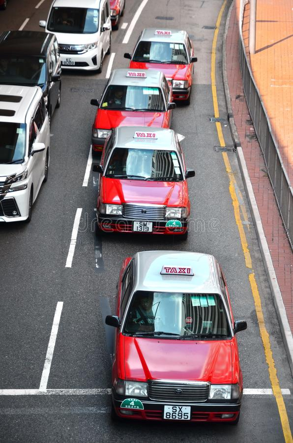 HONG KONG, CHINA - MARCH 13 2018: Line Of Taxis In Busy Hong Kong. Public, transport, sign, travel, vehicle, transportation, car, traffic, symbol, city royalty free stock image