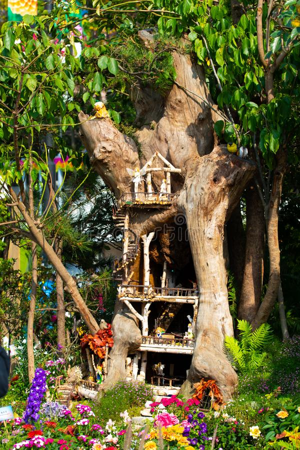 Flower fairy models in a treehouse. Hong Kong, China - March 18th 2018 : Miniature flower fairy models in a tree house display at the Hong Kong Flower Show 2018 stock photos