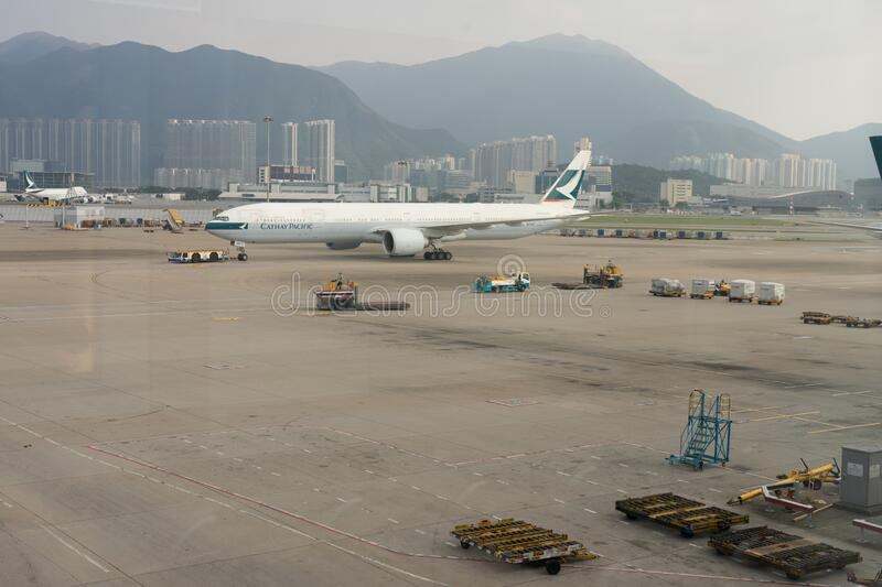 Hong Kong, China - November 12, 2019: Cathay Pacific plane on ground at Hong Kong airport. Pandemic situation effected all global. Airlines business royalty free stock images