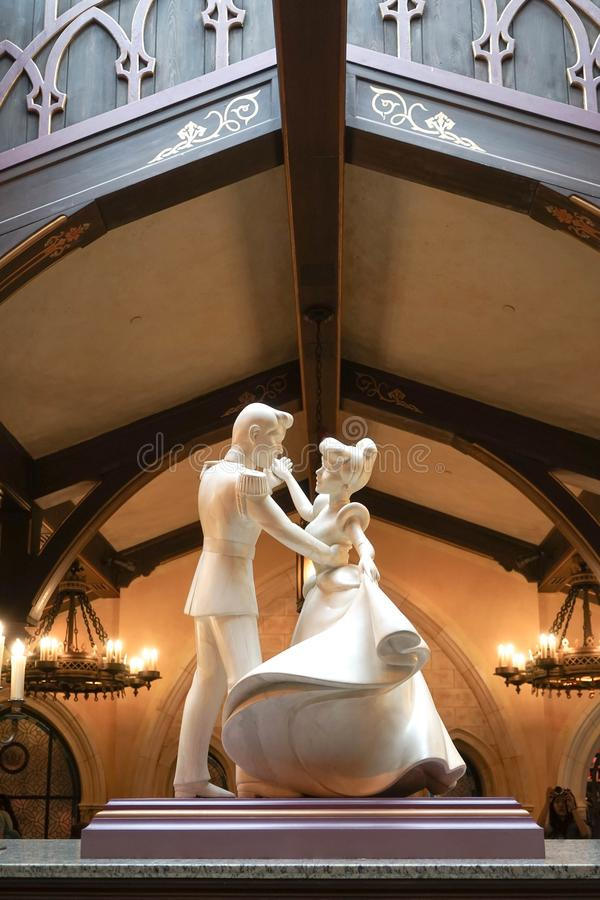 Stone sculpture of Cinderella and Prince charming dancing together stock images