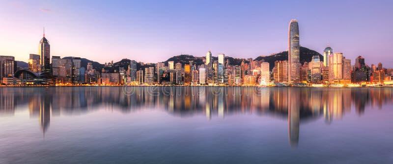 Hong Kong, China skyline across Victoria Harbor.  stock photo