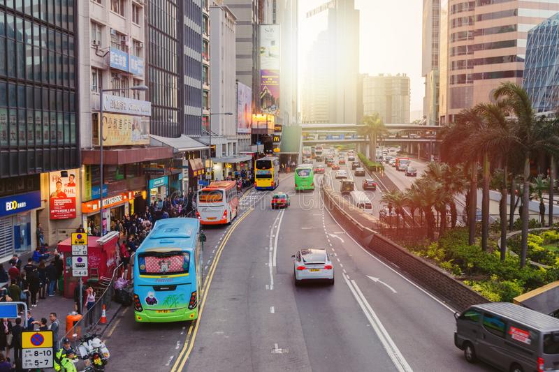 Street with daily life in big city- people crowds, transport, skyscraper. stock images