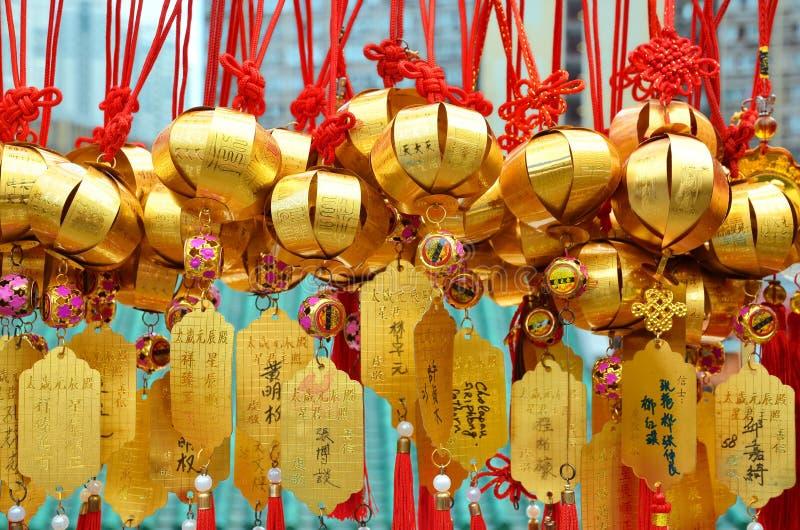 HONG KONG, CHINE - 13 MARS 2018 : Cloche sainte sur le mur pour le respect priant chez Wong Tai Sin Temple à l'île de Kowloon photographie stock libre de droits
