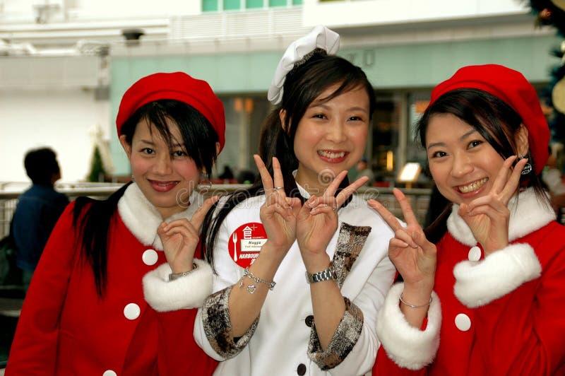 Hong Kong, Chiny: Azjatyckie kobiety w Bożenarodzeniowej odzieży fotografia royalty free