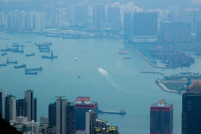 Hong Kong city, China - January, 2019: city landscape view from Victoria peak. Business building and skyscrapers in Hong. Kong city from Victoria harbour, China stock images