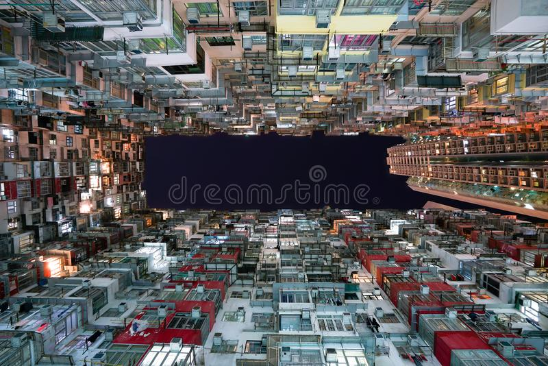 Hong Kong city residences area. Low angle view image of a crowded residential building in community in Quarry Bay at night, Hong stock photography