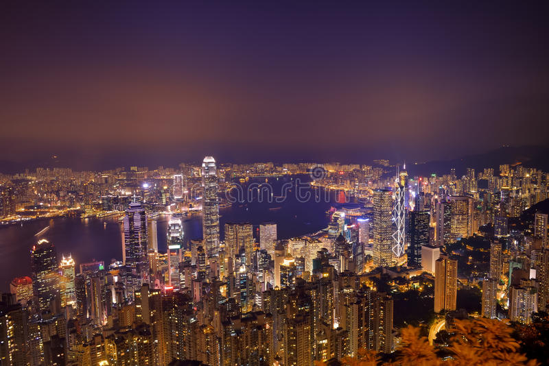 Hong Kong city skyline panorama at night with Victoria Harbor. And skyscrapers royalty free stock image