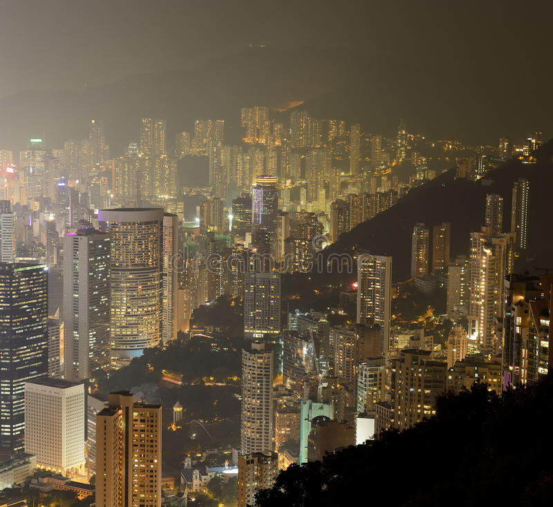 Hong Kong city skyline panorama at night with Victoria Harbor. And skyscrapers stock photography