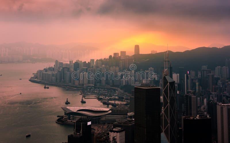 Hong Kong City skyline at sunrise. Hongkong skyscraper view from victoria peak.  stock photo