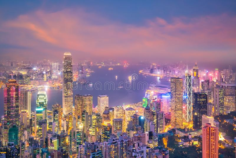Hong Kong city skyline with Victoria Harbor view. At twilight from top view stock photography