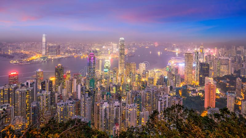 Hong Kong city skyline with Victoria Harbor view. At twilight from top view royalty free stock photos