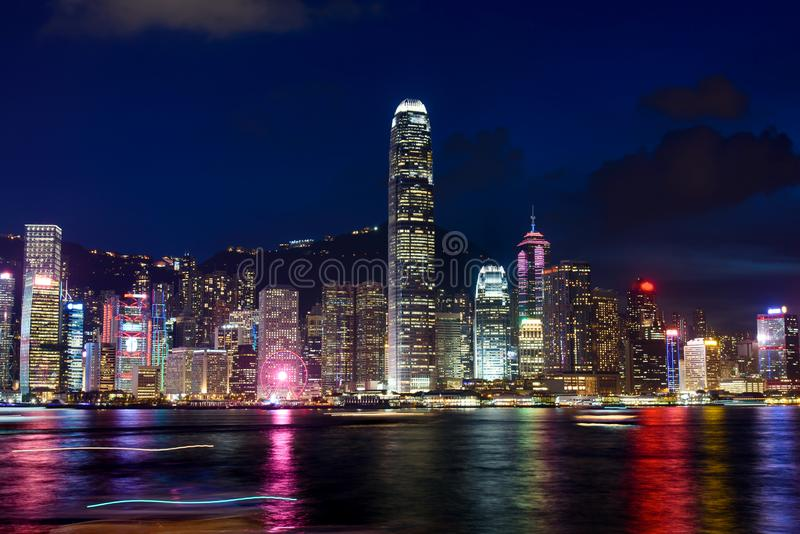 Hong Kong cityscape view from Victoria harbor at night stock photo